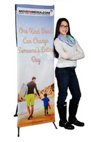 Woman standing next to banner